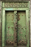 Green carved door in Stone Town, Zanzibar. Wooden green door in ancient Stone Town, Zanzibar, Tanzania royalty free stock image