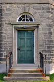 Door in a stone wall Royalty Free Stock Photography