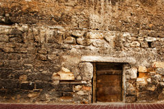 Door in the stone wall. Stock Images