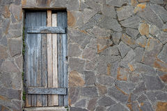 Door and stone wall Stock Images