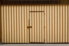 Door in striped wall. Brown light and dark royalty free stock photo
