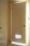 Door to bathroom is open with light Stock Images