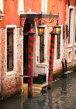 Door to canal in Venice. Door stright to canal in Venice Royalty Free Stock Image