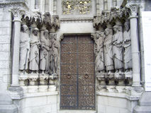 The door to the Cathedral. Great door to the cathedral with old statues Royalty Free Stock Image