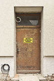 Door to a construction site with warning sign for no trespassing Royalty-vrije Stock Fotografie