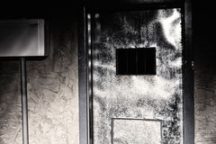 Door to the dark prison cell Royalty Free Stock Images