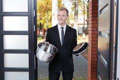 Door to door salesman. Selling stainless jug stock photos