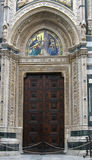 Door to the duomo church in florence. Door to the magnificent renaissance duomo basilica in florence italy Stock Photography