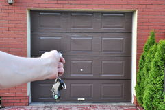 The door to the garage. Opened the garage door remote control Stock Photos