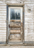 Door to ghost town house Stock Photo