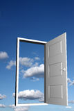 Door to heaven. Open doorway with sky and clouds in the background Stock Image