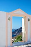 The door to heaven. This door is like the sky. In its open doorway, with amazing scenery. The bright blue sky on the horizon merges with the blue Mediterranean Royalty Free Stock Image