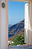 The door to heaven. Santorini, the island is of volcanic origin. It rises above the waters of a mountain ridge in the Mediterranean Sea. On top of that dark Royalty Free Stock Photo