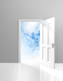 Door to heaven, spirituality and enlightenment concept of an open doorway to dreamy clouds. An open doorway leading to a peaceful sight of fluffy bright clouds Royalty Free Stock Photography