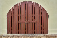 Door to the house. Gates into a house made of wooden planes painted brown Stock Photos