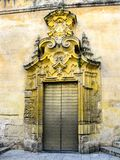 Door to Mezquita of Cordoba in Andalucia, Spain. Famous landmark in Spain. Beautiful cathedral Mezquita of Cordoba, Andalucia. Door with details in yellowish Stock Photo