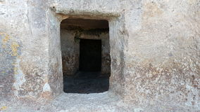 The door to a neolithic tomb in Montessu's necropolis. royalty free stock photos