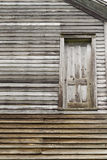The Door To Nowhere. Historical wooden building with a misplace door that leads to nowhere.  Fayette State Park.  Fayette, Michigan Royalty Free Stock Photos