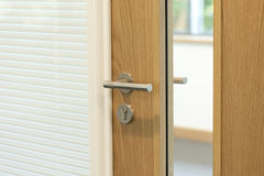 Door to office. Door focused on handle to a modern office Royalty Free Stock Images