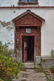 The   door to the old dilapidated house. Stock Photos