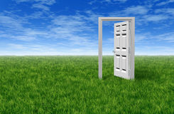 Door To Opportunity. With a grass field  and an open door to success and freedom showing the entrance to hope and prosperity for business and family Royalty Free Stock Images