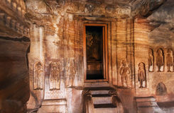Door to sanctuary of the 7th century cave temple in Karnataka, India. Structure dedicated to the Jain Lord Mahavira. Stock Photo