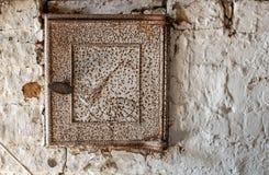 The door to the stove furnace. Old rusty door to the stove furnace Stock Image