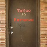 Door to tattoo parlor. Royalty Free Stock Photo