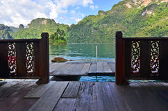 Door to walkway bridge in the lake. With green forest mountain Royalty Free Stock Photos