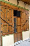 Door with two wooden windows. Door with two wooden windows with two shutters in arc of brown color Stock Photo