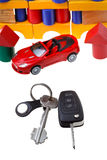 Door, vehicle keys, red car model and block house Royalty Free Stock Photo