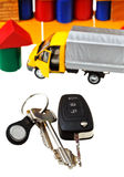 Door, vehicle keys, truck model and block house Stock Image