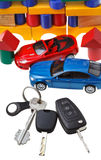 Door, vehicle keys, two car models and block house Royalty Free Stock Photos