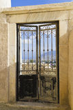 Door with a view. A doorway with pretty doors and a view of Santorini through it Stock Photography