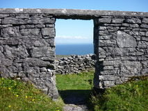 A door. View on the nice blue ocean through a door of a ruined house. Inis Mor, Ireland royalty free stock photos