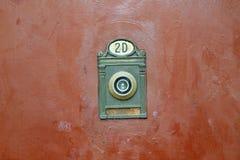 Door viewer. Vintage style door eye viewer on the grungy old painted metal door Stock Image