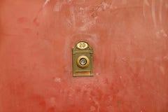 Door viewer. Vintage door viewer on the grungy old painted metal door Royalty Free Stock Image