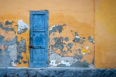 The door in the wall of an abandoned house. Blue door in the wall of an abandoned house Royalty Free Stock Photos