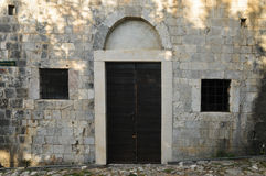 The door in the wall of masonry. Montenegro. The door in the wall of masonry of the medieval town Old Bar Stock Photos