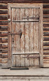 Door in wall of an old log house Stock Images