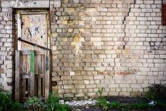 Door in a wall Stock Images