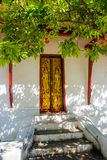 The door and wall painting.Buddhist temple with gold.Luang Prabang.Laos. Stock Image