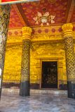 The door and wall painting.Buddhist temple with gold.Luang Prabang.Laos. Royalty Free Stock Photo