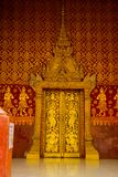 The door and wall painting.Buddhist temple with gold.Luang Prabang.Laos. Stock Photo