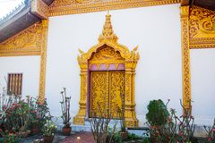 The door and wall painting.Buddhist temple with gold.Luang Prabang.Laos. Stock Photos