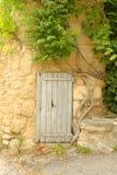 Door in the wall Stock Images