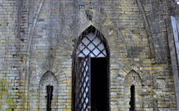 Door in a wall of a a ruined castle Stock Photo