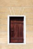 Door in a wall. Wooden vintage brown door in the wall Stock Image