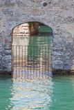 Door in the water in Scaliger Castle in Sirmione. Garda Lake - Travel destination in Italy. Door in the water in Scaliger Castle in Sirmione. Garda Lake Royalty Free Stock Image