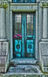 The door way. A pair of doors worn by time with a flower on it Royalty Free Stock Photography